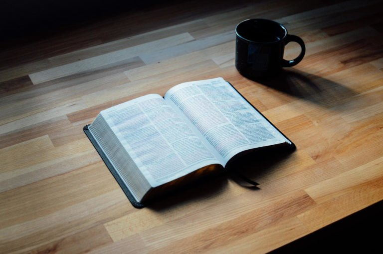 bible and coffee cup on wooden table 10 most helpful posts simple theology messy life