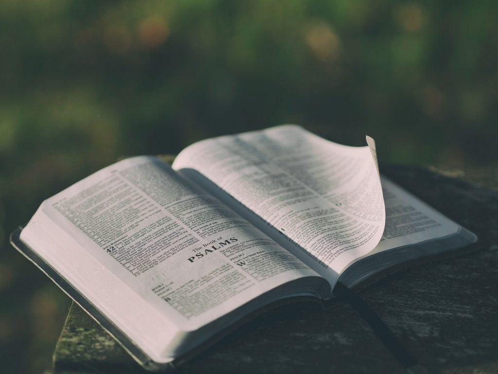 bible on outdoor table open to book of psalms