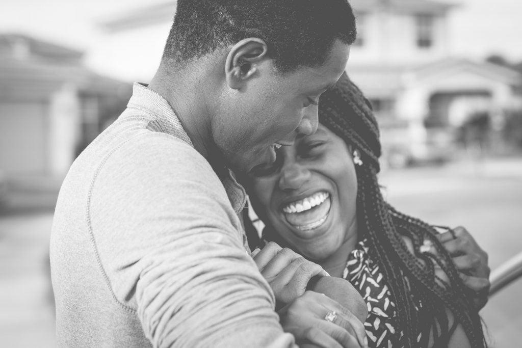 couple laughing and embracing_man loves wife