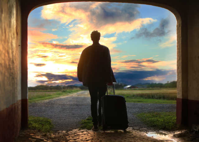 man departing on adventure with suitcase depicting leaving social media